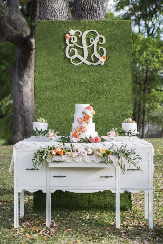 Dessert-Display-with-a-Floral-Wall-and-Monogram-min