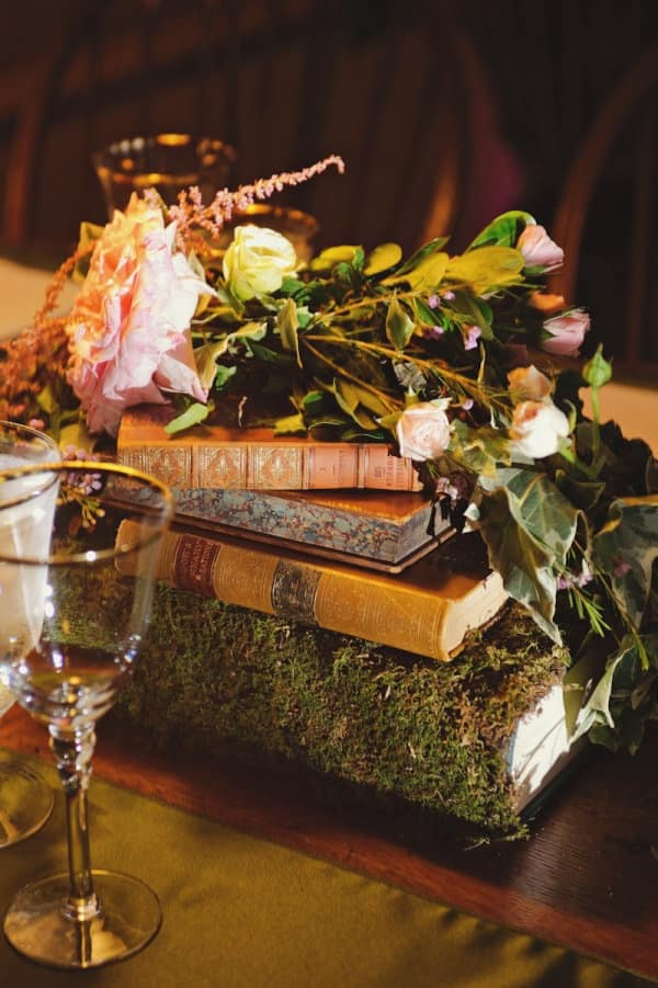 Pretty-moss-covered-books-as-centerpieces-min